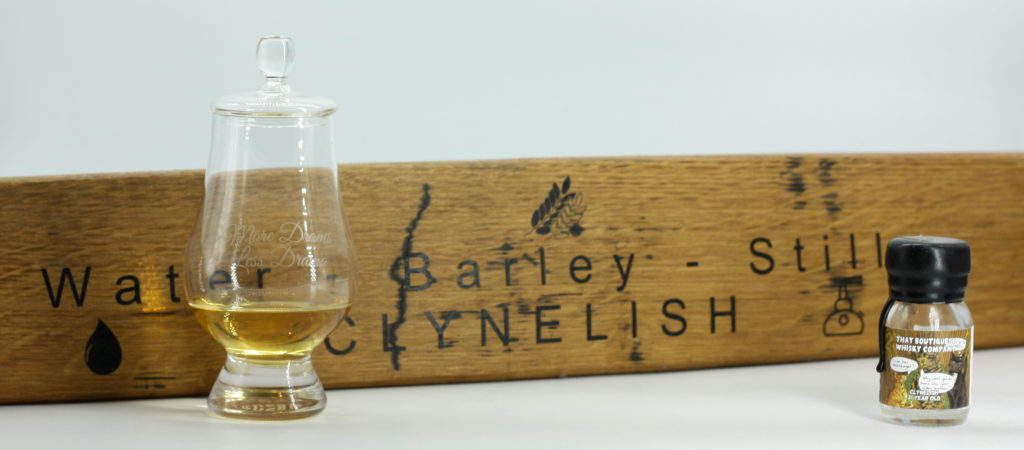 Glass of Clynelish in front of an engraved stave from Clynelish